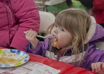 eating pancakes, little girl